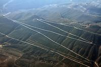A road on a hillside on the Qinghai-Tibetan Plateau. China.