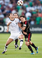 PASADENA, CA – June 25, 2011: USA player Eric Lichaj (14) and Mexican player Andres Guardado (18) during the Gold Cup Final match between USA and Mexico at the Rose Bowl in Pasadena, California. Final score USA 2 and Mexico 4.