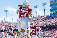 STANFORD, CA - AUGUST 30, 2014:  Christian McCaffrey celebrates his touchdown during Stanford's game against UC Davis. The Cardinal defeated the Aggies 45-0.