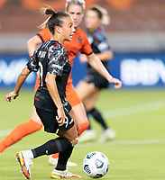 HOUSTON, TX - SEPTEMBER 10: Mallory Pugh #9 of the Chicago Red Stars looks to pass the ball during a game between Chicago Red Stars and Houston Dash at BBVA Stadium on September 10, 2021 in Houston, Texas.