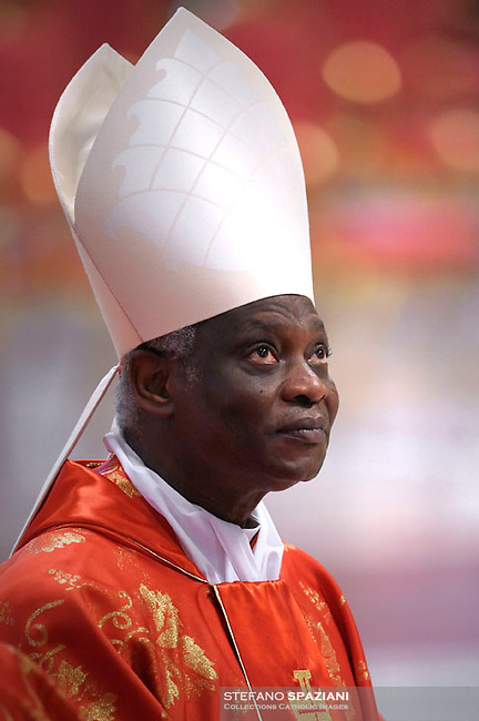 Ghanaian cardinal Peter Kodwo Appiah Turkson.Dean of the College of Cardinals Angelo Sodano leads a  during a Mass for the election of a new pope, at the St Peter's basilica on March 12, 2013 at the Vatican. The 115 cardinal electors who pick the next leader of 1.2 billion Catholics in a conclave in the Sistine Chapel will live inside the Vatican walls completely cut off from the outside world until they have made their choice..