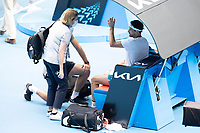 16th February 2021, Melbourne, Victoria, Australia; Grigor Dimitrov of Bulgaria seeks medical assistance during the quarterfinals of the 2021 Australian Open on February 16 2021, at Melbourne Park in Melbourne, Australia.