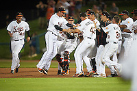 Frederick Keys left fielder Jay Gonzalez (13) is mobbed by teammates, including Luis Gonzalez (48), Michael Zouzalik (28), Wynston Sawyer (14), Conor Bierfeldt (43), Cameron Kneeland (39), Franderlin Romero (47), after a walk off base hit during a game against the Carolina Mudcats on June 4, 2016 at Nymeo Field at Harry Grove Stadium in Frederick, Maryland.  Frederick defeated Carolina 5-4 in eleven innings.  (Mike Janes/Four Seam Images)