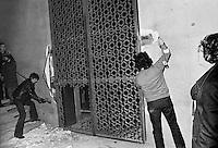 - Milan, adherents of leftist group CAF (Anti-fascist Committees) demolish during the night the great hall gates that the president of State University had made install for prevent students meetings (january 1977)....- Milano, aderenti al gruppo di sinistra CAF (Comitati Antifascisti) abbattono nottetempo il cancello che il Rettore dell'Università Statale aveva fatto installare per impedire agli studenti l'accesso all'aula magna per tenervi assemblee (gennaio 1977)