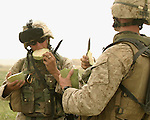 HIT, Iraq- (July 4, 2005) Marines from 25th Marine Regiment, 3rd Battalion, India Company and a member of the Iraqi Security Force stop to eat some watermelon during a patrol. During Operation River Sweep III, the Marines of 2d Marine Division conduct counter- insurgency operations with Iraqi Security Forces to isolate and neutralize anti-Iraqi forces, to support the continued development of Iraqi Security Forces, and to support Iraqi reconstruction and democratic elections in order to create a secure environment that enables Iraqi self-reliance and self-governance. (Official USMC photo by LCpl. Shane S. Keller)