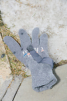 A glove featuring the name Trump is seen on the ground on the day of New Hampshire Presidential Primary voting in Manchester, New Hampshire, on Tue., Feb. 11, 2020.