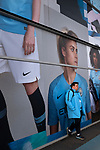 Manchester City 4, Tottenham Hotspur 3, 17/04/2019. Etihad Stadium, Champions League. A man leaning against an advertising hoarding outside the Etihad Stadium before Manchester City played Tottenham Hotspur in a Champions League quarter final, second league. The first leg was played the previous week at Spurs' new stadium which they won 1-0. The second lead resulted in a 4-3 win for City however Tottenham progressed to the semi-finals against Ajax on the away goal rule as the teams finished 4-4 on aggregate. Photo by Colin McPherson.