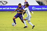 KANSAS CITY, KS - SEPTEMBER 23: Ruan #2 of Orlando City holds off Gerso Fernandes #12 of Sporting Kansas City during a game between Orlando City SC and Sporting Kansas City at Children's Mercy Park on September 23, 2020 in Kansas City, Kansas.