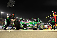 Feb 21, 2009; Fontana, CA, USA; NASCAR Nationwide Series driver Carl Edwards pits during the Stater Brothers 300 at Auto Club Speedway. Mandatory Credit: Mark J. Rebilas-