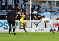 Thursday 08 August 2013<br /> Pictured L-R: Ashley Richards of Swansea kicking the ball away, challenged by Magnus Eriksson of Malmo <br /> Re: Malmo FF v Swansea City FC, UEFA Europa League 3rd Qualifying Round, Second Leg, at the Swedbank Stadium, Malmo, Sweden.