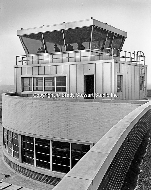 Pittsburgh PA:  View of the Airport Tower and air traffic controllers at Greater Pittsburgh Airport. In 1944, Allegheny County officials proposed to expand the military airport with the addition of a commercial passenger terminal in order to relieve the Allegheny County Airport, which was built in 1926 and whose capacity was quickly becoming insufficient to support the growing demand for air travel.  The new airport, christened as Greater Pittsburgh Airport opened on May 31, 1952. The first flight occurred on June 3, 1952.