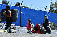 Pictured: A young family of migrants at the refugee camp Tuesday 23 February 2016<br /> Re: Migrants at a refugee camp in the Schisto area of Athens, Greece.