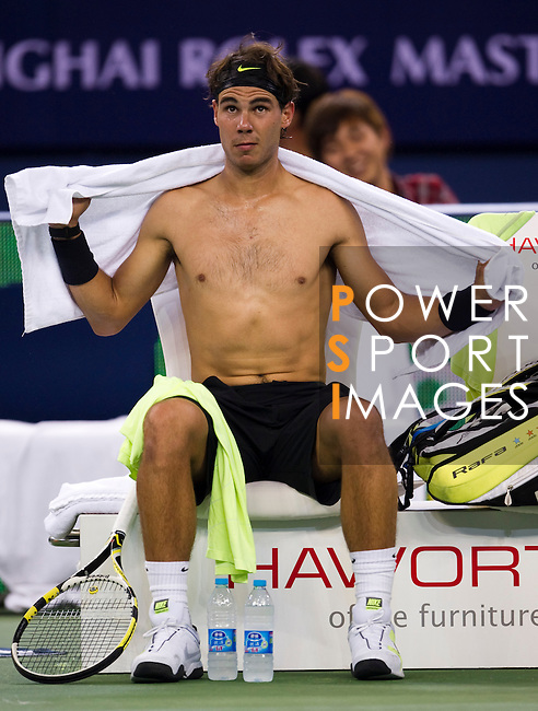 SHANGHAI, CHINA - OCTOBER 13:  Rafael Nadal of Spain changes his jersey during his match against Stanislas Wawrinka of Switzerland during day three of the 2010 Shanghai Rolex Masters at the Shanghai Qi Zhong Tennis Center on October 13, 2010 in Shanghai, China.  (Photo by Victor Fraile/The Power of Sport Images) *** Local Caption *** Rafael Nadal