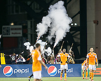 Revolution players celebrate in the background as the Gillette minutemen commemorate a goal scored.<br />   The New England Revolution played to a 1-1 draw against the Houston Dynamo during a Major League Soccer (MLS) match at Gillette Stadium in Foxborough, MA on September 28, 2013.