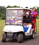 HAIKOU, CHINA - OCTOBER 28: Multiple Olympic gold medalist Michael Phelps of USA drives a buggy during the pro-am for the Mission Hills Star Trophy on October 28, 2010 in Haikou, China. The Mission Hills Star Trophy is Asia's leading leisure liflestyle event and features Hollywood celebrities and international golf stars. Photo by Victor Fraile / The Power of Sport Images