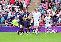 August 06, 2012..Japan's Mizuho Sakaguchi #6, Japan's Yuki Ogimi #17 and Japan's Saki Kumagai celebrate after scoring against Japan during Semi Final match at the Wembley Stadium on day ten in Wembley, England. Japan defeats France 2-1 to reach Women's Finals of the 2012 London Olympics.