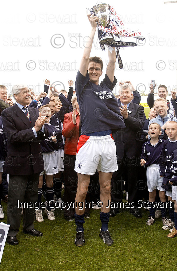 07/05/2005         Copyright Pic : James Stewart.File Name : jspa04_falkirk_v_qots.KEVIN JAMES LIFTS THE FIRST DIVISION TROPHY.Payments to :.James Stewart Photo Agency 19 Carronlea Drive, Falkirk. FK2 8DN      Vat Reg No. 607 6932 25.Office     : +44 (0)1324 570906     .Mobile   : +44 (0)7721 416997.Fax         : +44 (0)1324 570906.E-mail  :  jim@jspa.co.uk.If you require further information then contact Jim Stewart on any of the numbers above.........A