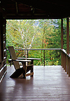 Adirondack chair on porch with woods in background, Adirondack Museum, Blue Mountain Lake, Hamilton County, Adirondack State Park, N