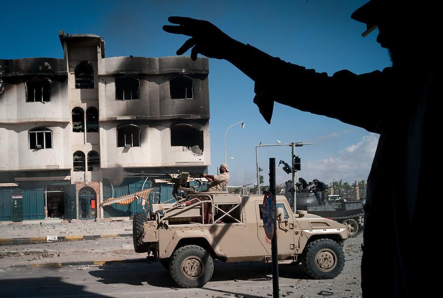 Anti-Gaddafi fighters attempt to dislodge pro-Gaddafi snipers in Sirte, Libya.
