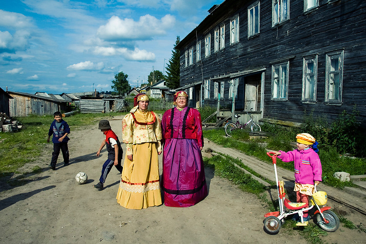 Anna and Olga are dressed traditional russian clothes of northern regions. They sing in a local folk group and dream about more tourists to come to Kenozero