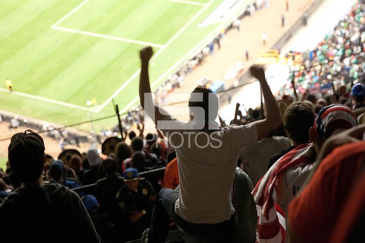 USA fans cheer on their team at Azteca stadium  during the USA vs. Mexico World Cup Qualifier in Mexico City, Mexico on March 26, 2013.