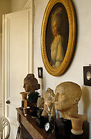 Hellenistic, Etruscan and Roman heads line the kitchen mantelpiece while a portrait of the Comtesse de Provence hangs above it