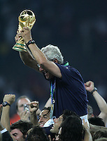 Italian head coach Marcello Lippo raises the World Cup.  Italy defeated France on penalty kicks after leaving the score tied, 1-1, in regulation time in the FIFA World Cup final match at Olympic Stadium in Berlin, Germany, July 9, 2006.