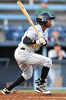 West Virginia left fielder Junior Sosa #28 swings at a pitch during a game between the West Virginia Power and the Asheville Tourists at McCormick Field, Asheville, North Carolina April 10, 2012. The Tourists won 6-5  (Tony Farlow/Four Seam Images)..