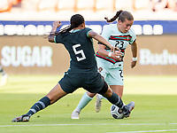 HOUSTON, TX - JUNE 13: Onome Ebi #5 of Nigeria tackles Telma Encarnacao #23 of Portugal during a game between Nigeria and Portugal at BBVA Stadium on June 13, 2021 in Houston, Texas.
