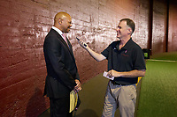 LOS ANGELES, CA - SEPTEMBER 11: Head coach David Shaw of the Stanford Cardinal speaks with Scott Reiss of the Cardinal Sports Network before a game between University of Southern California and Stanford Football at Los Angeles Memorial Coliseum on September 11, 2021 in Los Angeles, California.