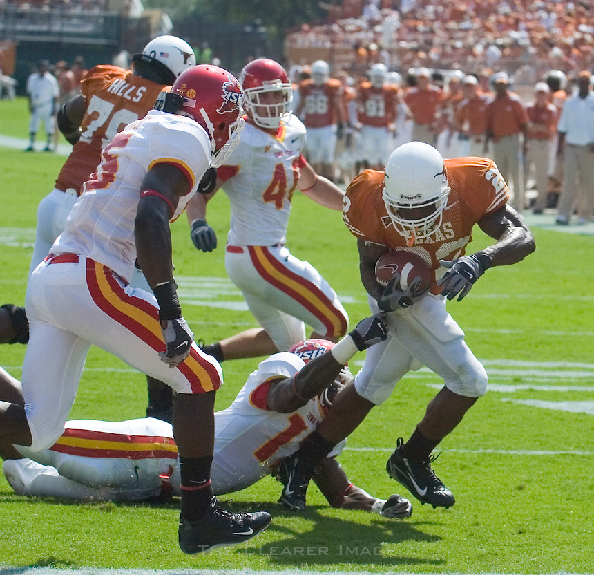 23 September 2006: Texas back Selvin Young breaks a tackle on his way to a touchdown during the Longhorns 37-14 victory over the Iowa State Cyclones at Darrell K Royal Memorial Stadium in Austin, TX.
