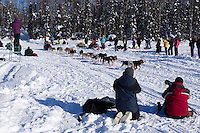 Sunday, March 4, 2012  Trent Herbst  passes spectators on Long Lake at the restart of Iditarod 2012 in Willow, Alaska.