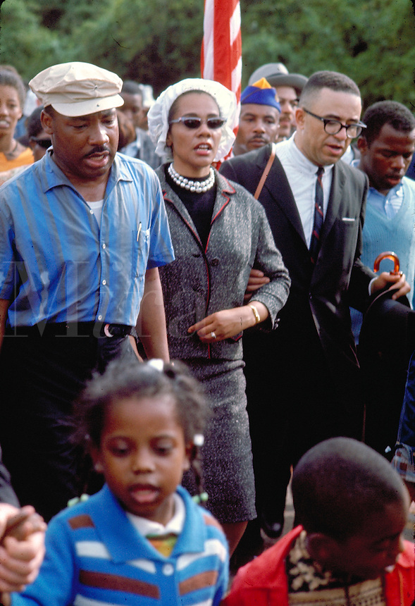 Selma to Montgomery March for voting rights. Martin Luther King and Coretta Scott King marching and singing with their daughter, Bernice Albertine King. Civil Rights leaders. Black. African American.