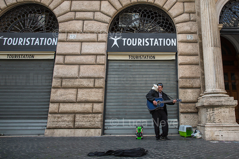 """Vladimir, Singer.<br /> <br /> Rome, 12/03/2020. Documenting Rome under the Italian Government lockdown for the Outbreak of the Coronavirus (SARS-CoV-2 - COVID-19) in Italy. On the evening of the 11 March 2020, the Italian Prime Minister, Giuseppe Conte, signed the March 11th Decree Law """"Step 4 Consolidation of 1 single Protection Zone for the entire national territory"""" (1.). The further urgent measures were taken """"in order to counter and contain the spread of the COVID-19 virus"""" on the same day when the WHO (World Health Organization, OMS in Italian) declared the coronavirus COVID-19 as a pandemic (2.).<br /> ISTAT (Italian Institute of Statistics) estimates that in Italy there are 50,724 homeless people. In Rome, around 20,000 people in fragile condition have asked for support. Moreover, there are 40,000 people who live in a state of housing emergency in Rome's municipality.<br /> March 11th Decree Law (1.): «[…] Retail commercial activities are suspended, with the exception of the food and basic necessities activities […] Newsagents, tobacconists, pharmacies and parapharmacies remain open. In any case, the interpersonal safety distance of one meter must be guaranteed. The activities of catering services (including bars, pubs, restaurants, ice cream shops, patisseries) are suspended […] Banking, financial and insurance services as well as the agricultural, livestock and agri-food processing sector, including the supply chains that supply goods and services, are guaranteed, […] The President of the Region can arrange the programming of the service provided by local public transport companies […]».<br /> Updates: on the 12.03.20 (6:00PM) in Italy there 14.955 positive cases; 1,439 patients have recovered; 1,266 died.<br /> <br /> Footnotes & Links:<br /> Info about COVID-19 in Italy: http://bit.do/fzRVu (ITA) - http://bit.do/fzRV5 (ENG)<br /> 1. March 11th Decree Law http://bit.do/fzREX (ITA) - http://bit.do/fzRFz (ENG)<br /> 2. http://bit.do/fzRKm"""