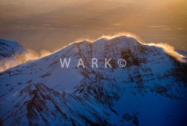 Sun rim on mountain peak. Sangre de Cristo Range, Custer County, Colorado. Feb 2013. 82590
