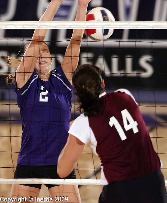 SIOUX FALLS, SD - OCTOBER 3:  Danielle Roers #2 of the University of Sioux Falls tries tries for a block against Emily Christen #14 of Morningside College in the second game of their match Saturday afternoon at the Stewart Center. (Photo by Dave Eggen/Inertia).