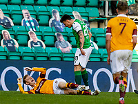24th April 2021; Easter Road, Edinburgh, Scotland; Scottish Cup fourth round, Hibernian versus Motherwell; McGinley of Motherwell react to the challenge from Hallberg of Hibs