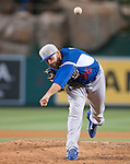 Los Angeles Dodgers pitcher Paco Rodriguez throws a breaking ball against the Los Angeles Angels.