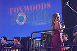 Hostess Courtney Friel records an intro in front of the Foxwoods sign.