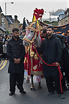 Muslim community Bradford UK. 2019 2010s. Day of Ashura parade Shia Muslims remember the martyrdom of Hussain. The horse represents the one that Husayn ibn Ali rode into Battle of Karbala in today's Iraq in A.D. 680.