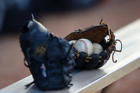 Ball State Cardinals gloves and baseballs on the bench after a game against the Dartmouth Big Green on March 7, 2015 at North Charlotte Regional Park in Port Charlotte, Florida.  Ball State defeated Dartmouth 7-4.  (Mike Janes/Four Seam Images)