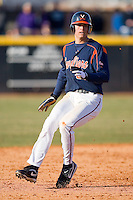 Jarrett Parker #3 of the Virginia Cavaliers rounds second base at Clark-LeClair Stadium on February 19, 2010 in Greenville, North Carolina.   Photo by Brian Westerholt / Four Seam Images