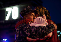 101130-N-7981E-032 CORONADO (Nov. 30, 2010)- Aviation Boatswain's Mate (Handling) Airman Andrew Eritano, assigned to Air Department, V-1 Division, says goodbye to his wife and daughter as USS Carl Vinson (CVN 70) departs Naval Air Station North Island for a three-week composite training unit exercise (CTX) and Western Pacific deployment. (U.S. Navy photo by Mass Communication Specialist 2nd Class James R. Evans / RELEASED)