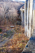 """Just to the left of this bridge is the location of where a timber trestle once crossed over Lafayette Brook along the Profile & Franconia Notch Railroad in Franconia, New Hampshire. The bridge in view was not there when the trestle was in place. This trestle was known as """"The Great Trestle"""". The railroad was in operation from 1879-1921, and only serviced the Profile House in Franconia Notch."""