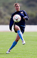 USWNT defender Shannon Boxx kicks the ball forward during practice for the Algarve Cup in Albufeira, Portugal.