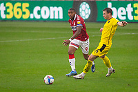 3rd October 2020; Riverside Stadium, Middlesbrough, Cleveland, England; English Football League Championship Football, Middlesbrough versus Barnsley; Britt Assombalonga of Middlesbrough FC passes the ball under pressure from Michael Sollbauer of Barnsley FC