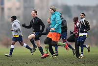 Ahtletico Angels players warm up before kick-off - Delta (black/white) vs Athletico Angels - Hackney & Leyton League at South Marsh, Hackney - 07/02/10 - MANDATORY CREDIT: Gavin Ellis/TGSPHOTO - Self billing applies where appropriate - Tel: 0845 094 6026