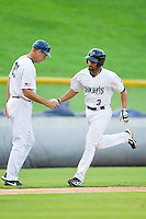 Marcus Semien (3) of the Charlotte Knights shakes hands with third base coach Joel Skinner (37) after hitting a home run against the Lehigh Valley IronPigs at Knights Stadium on August 6, 2013 in Fort Mill, South Carolina.  The IronPigs defeated the Knights 4-1.  (Brian Westerholt/Four Seam Images)