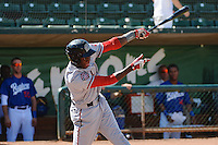 Aristides Aquino (63) of the Billings Mustangs at bat against the Ogden Raptors at Lindquist Field on August 18, 2013 in Ogden Utah.  (Stephen Smith/Four Seam Images)