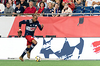 FOXBOROUGH, MA - SEPTEMBER 11: Teal Bunbury #10 of New England Revolution dribbles down the wing during a game between New York City FC and New England Revolution at Gillette Stadium on September 11, 2021 in Foxborough, Massachusetts.